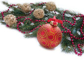 Christmas Decoration: Christmas red ball, twig of fir and beads — Stock Photo