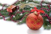 Christmas red ball, twig of fir , beads and star — Stock Photo