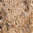 Pillar of stone with ancient Roman text in Byblos, Lebanon — Stock Photo #64348787