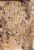 Pillar of stone with ancient Roman text in Byblos, Lebanon — Stock Photo
