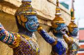 Garuda statues in the Grand Palace. Temple of the Emerald Buddha. Gold ornamental patters.Wat Pra-keaw Bangkok,Thailand. — Stock Photo