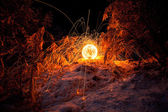 Fire painting, light painting with sparks at winter — Stock Photo