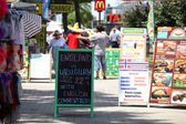 SUNNY BEACH, BULGARIA - JUNE 19: People visit Sunny Beach on June 19, 2014. Sunny Beach is the largest and most popular seaside beach resort in Bulgaria. — Stock Photo
