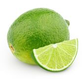 Citrus lime fruit with slice isolated on white — Stock Photo