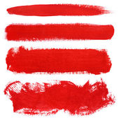 Red strokes of gouache paint brush — Stock Photo