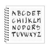 Chalck алфавит на спираль ноутбук бумаге — Cтоковый вектор