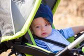 Babby boy in stroller — Stock Photo