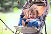 Baby boy in stroller outdoor — Stock Photo
