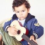 Boy playing guitar — Stock Photo #63613531