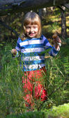 Running little girl in the forest — Stock Photo
