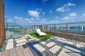 Roof terrace with jacuzzi and sun lounger — Stock Photo