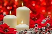 White candles in autumn winter decoration — Stock Photo