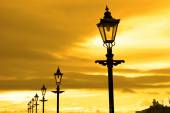 Row of vintage lamps at sunset — Stock Photo