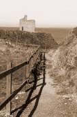Sepia fenced path to Ballybunion beach — Stock Photo