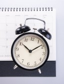 Alarm clock with calendar. alarm clock with calendar on the back — Stock Photo