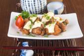 Japanese cuisine. fried chicken on the background — Stockfoto