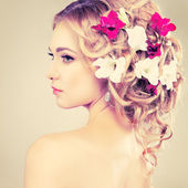 Beautiful girl with flowers in hair — Stock Photo