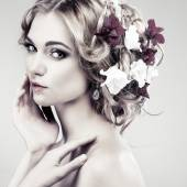 Beautiful girl with flowers — Stock Photo