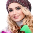 A photo of beautiful girl is in winter clothes with varicoloured gift boxes,  isolated — Stock Photo #53346819