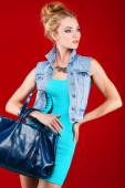 A photo of beautiful girl is in fashion style on  red  background, glamour — Foto de Stock