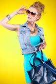 A photo of beautiful girl is in fashion style on  yellow  background, glamour — Photo