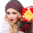 A photo of beautiful girl is in winter clothes with varicoloured gift boxes, isolated — Stock Photo #53450237