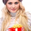 A photo of beautiful girl is in winter clothes with varicoloured gift boxes, isolated — Stock Photo #53450255
