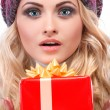A photo of beautiful girl is in winter clothes with varicoloured gift boxes, isolated — Stock Photo #53450267