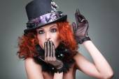 Portrait of beautiful sexual redheaded girl in a black hat on a grey background. Accessories. — Stock Photo