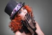 Portrait of beautiful sexual redheaded girl in a black hat on a grey background. Accessories. — Foto Stock