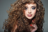 Young beautiful woman with long curly hairs — Стоковое фото