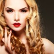 Closeup portrait of sexy  young woman with beautiful blue eyes and red lips  on a grey background — Stock Photo #74483131