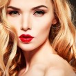Closeup portrait of sexy  young woman with beautiful blue eyes and red lips on a grey background — Stock Photo #74483141