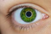 Close up of a green woman eye — Stock Photo