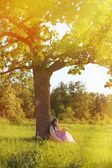 Woman reading book in the park — Stock Photo