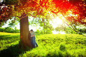 Romantic young couple relaxing outdoors in park — Stock Photo