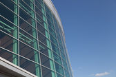 Close-up round office building with blue sky — Foto de Stock