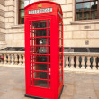Traditional red telephone box in London UK — Stock Photo #62260993