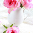 Beautiful romantic pink roses in a white vase — Stock Photo #66815039
