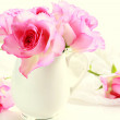 Beautiful romantic pink roses in a white vase — Stock Photo #66815149