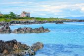 Iona is a small island in the Inner Hebrides off the Ross of Mull on the western coast of Scotland. — Stock Photo