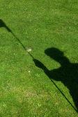 Flag  shadow on golf hole — Stock Photo
