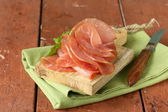 Smoked pork ham on cutting wooden board — Stockfoto