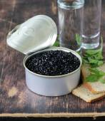 Caviar with rye bread and two shots vodka on a wooden table — Stock Photo