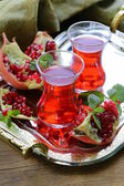 Pomegranate fruit tea in traditional glass cups — Stockfoto