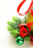 Christmas composition with champagne and festive decoration — Stock Photo
