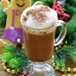Glass of hot chocolate and Christmas gingerbread man — Stock Photo #52482231
