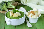 Vegetable broccoli cream soup with white croutons and parsley — Stock Photo
