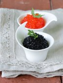 Traditional Russian delicacy red and black caviar — Stock Photo