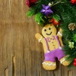 Traditional Christmas gingerbread man with festive decorations and Christmas tree — Stock Photo #53120859